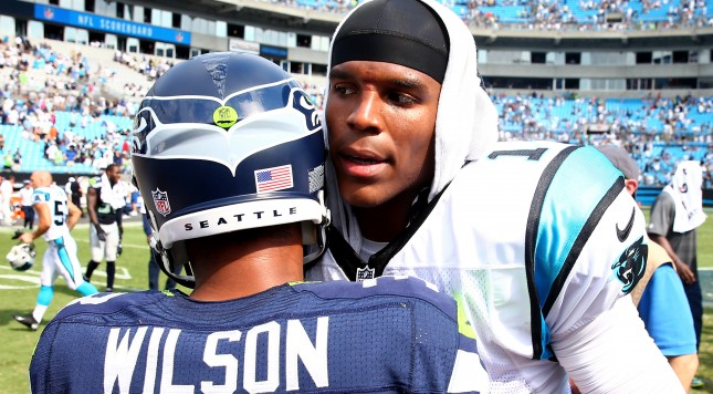 CHARLOTTE, NC - SEPTEMBER 08:   Cam Newton #1 of the Carolina Panthers congratulates Russell Wilson #3 of the Seattle Seahawks after their game at Bank of America Stadium on September 8, 2013 in Charlotte, North Carolina.  (Photo by Streeter Lecka/Getty Images)