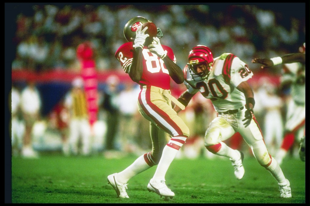 22 Jan 1989:  Wide receiver John Taylor #82 of the San Francisco 49ers makes a catch as defensive back Ray Horton #20 of the Cincinnati Bengals moves in during Super Bowl XXIII at the Joe Robbie Stadium in Miami, Florida.  The 49ers won the game 20-16.