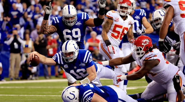 INDIANAPOLIS, IN - JANUARY 04: Quarterback Andrew Luck #12 of the Indianapolis Colts scores a touchdown in the fourth quarter after recovering a fumble against the Kansas City Chiefs during a Wild Card Playoff game at Lucas Oil Stadium on January 4, 2014 in Indianapolis, Indiana.  (Photo by Rob Carr/Getty Images)