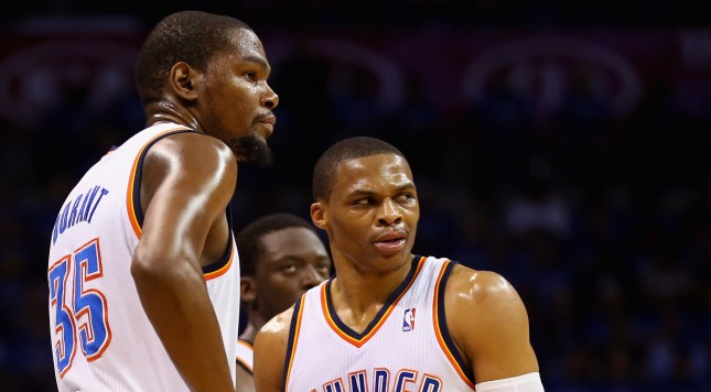 OKLAHOMA CITY, OK - MAY 25: Kevin Durant #35 and Russell Westbrook #0 of the Oklahoma City Thunder look on after a call in the second quarter against the San Antonio Spurs during Game Three of the Western Conference Finals of the 2014 NBA Playoffs at Chesapeake Energy Arena on May 25, 2014 in Oklahoma City, Oklahoma.  (Photo by Ronald Martinez/Getty Images)
