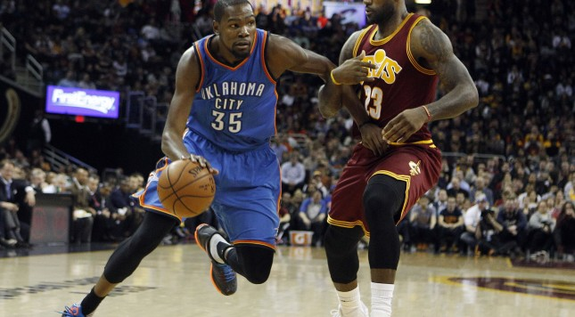 CLEVELAND, OH - DECEMBER 17: Kevin Durant #35 of the Oklahoma City Thunder drives to the basket against LeBron James #23 of the Cleveland Cavaliers during the first half of their game on December 17, 2015 at Quicken Loans Arena in Cleveland, Ohio. the Rockets defeated the Cavaliers 105-93. NOTE TO USER: User expressly acknowledges and agrees that, by downloading and or using this photograph, User is consenting to the terms and conditions of the Getty Images License Agreement. (Photo by David Maxwell/Getty Images)