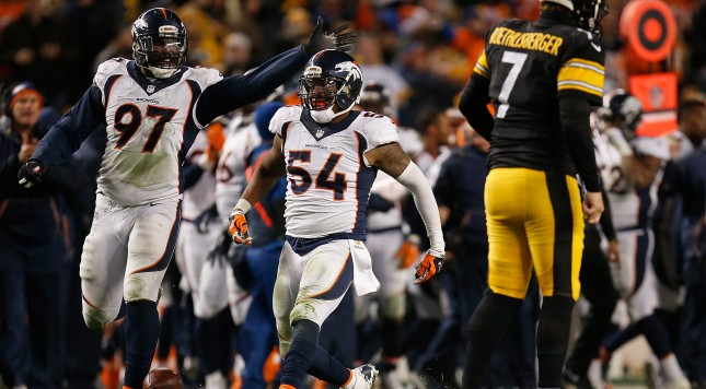 PITTSBURGH, PA - DECEMBER 20:  Brandon Marshall #54 of the Denver Broncos and Malik Jackson #97 of the Denver Broncos celebrate Marshall's fourth quarter interception during the game against the Pittsburgh Steelers at Heinz Field on December 20, 2015 in Pittsburgh, Pennsylvania. (Photo by Gregory Shamus/Getty Images)