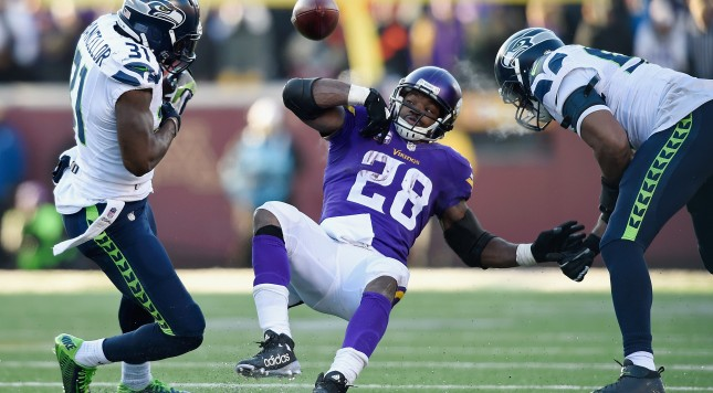 MINNEAPOLIS, MN - JANUARY 10:  Adrian Peterson #28 of the Minnesota Vikings fumbles the ball in the fourth quarter against the Seattle Seahawks during the NFC Wild Card Playoff game at TCFBank Stadium on January 10, 2016 in Minneapolis, Minnesota.  (Photo by Hannah Foslien/Getty Images)