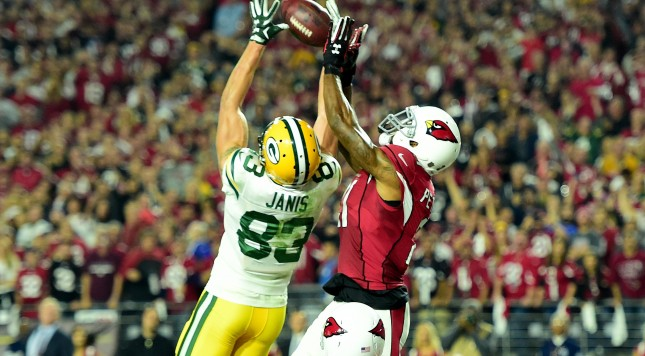 GLENDALE, AZ - JANUARY 16:  Wide receiver Jeff Janis #83 of the Green Bay Packers catches a 41-yard touchdown on the final play of regulation against cornerback Patrick Peterson #21 of the Arizona Cardinals in the NFC Divisional Playoff Game at University of Phoenix Stadium on January 16, 2016 in Glendale, Arizona.  (Photo by Harry How/Getty Images)