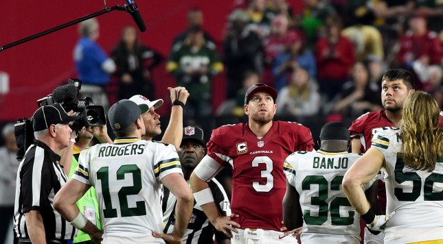 GLENDALE, AZ - JANUARY 16: Quarterback Carson Palmer #3 of the Arizona Cardinals and quarterback Aaron Rodgers #12 of the Green Bay Packers watch the overtime coin toss in the NFC Divisional Playoff Game at University of Phoenix Stadium on January 16, 2016 in Glendale, Arizona. The Arizona Cardinals beat the Green Bay Packers 26-20 in overtime.  (Photo by Norm Hall/Getty Images)