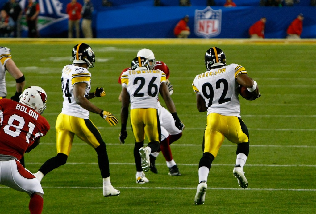 TAMPA, FL - FEBRUARY 01:  James Harrison #92 of the Pittsburgh Steelers runs back an interception for a touchdown in the second quarter against the Arizona Cardinals during Super Bowl XLIII on February 1, 2009 at Raymond James Stadium in Tampa, Florida.  (Photo by Win McNamee/Getty Images)