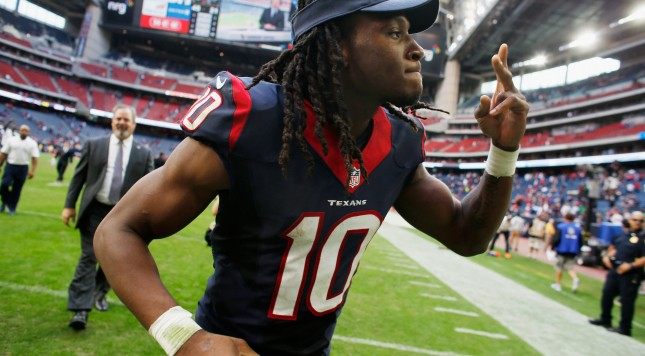 HOUSTON, TX - NOVEMBER 30:  DeAndre Hopkins #10 of the Houston Texans walks off the field afrter the Texans defeated the Tennessee Titans 45-21 at NRG Stadium on November 30, 2014 in Houston, Texas.  (Photo by Scott Halleran/Getty Images)
