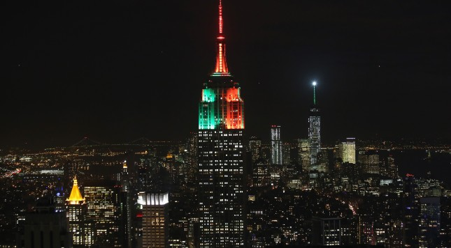 NEW YORK, NY - JANUARY 31:  The Empire State Building glows green for the Seattle Seahawks and orange for the Denver Broncos on January 31, 2014 as seen from the Top of the Rock in Midtown, Manhattan in New York City. The spire of One World Trade Center (R), was also lit up for the teams ahead of Sunday's Super Bowl XLVIII game at MetLife Stadium.  (Photo by John Moore/Getty Images)