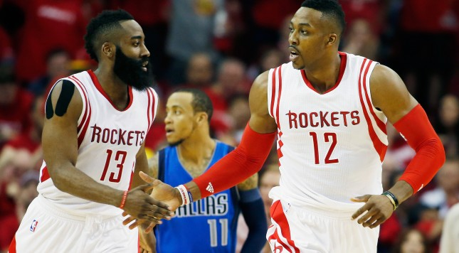 HOUSTON, TX - APRIL 18:  James Harden #13 and Dwight Howard #12 of the Houston Rockets celebrate a basket against the Dallas Mavericks during Game One in the Western Conference Quarterfinals of the 2015 NBA Playoffs on April 18, 2015 at the Toyota Center in Houston, Texas. NOTE TO USER: User expressly acknowledges and agrees that, by downloading and/or using this photograph, user is consenting to the terms and conditions of the Getty Images License Agreement.  (Photo by Scott Halleran/Getty Images)