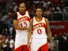 ATLANTA, GA - MAY 22:  Jeff Teague #0 and Al Horford #15 of the Atlanta Hawks react in the second quarter against the Cleveland Cavaliers during Game Two of the Eastern Conference Finals of the 2015 NBA Playoffs at Philips Arena on May 22, 2015 in Atlanta, Georgia. NOTE TO USER: User expressly acknowledges and agrees that, by downloading and or using this Photograph, user is consenting to the terms and conditions of the Getty Images License Agreement.  (Photo by Kevin C. Cox/Getty Images)