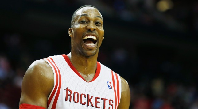 HOUSTON, TX - MARCH 01:  Dwight Howard #12 of the Houston Rockets walks across the court during the game against the Detroit Pistons at the Toyota Center on March 1, 2014 in Houston, Texas. NOTE TO USER: User expressly acknowledges and agrees that, by downloading and or using this photograph, User is consenting to the terms and conditions of the Getty Images License Agreement.  (Photo by Scott Halleran/Getty Images)