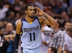 PHOENIX, AZ - APRIL 14:  Mike Conley #11 of the Memphis Grizzlies salutes his bench after hitting a three point shot against the Phoenix Suns during the second half of the NBA game at US Airways Center on April 14, 2014 in Phoenix, Arizona.   The Grizzlies defeated the Suns 97-91.  NOTE TO USER: User expressly acknowledges and agrees that, by downloading and or using this photograph, User is consenting to the terms and conditions of the Getty Images License Agreement.  (Photo by Christian Petersen/Getty Images)