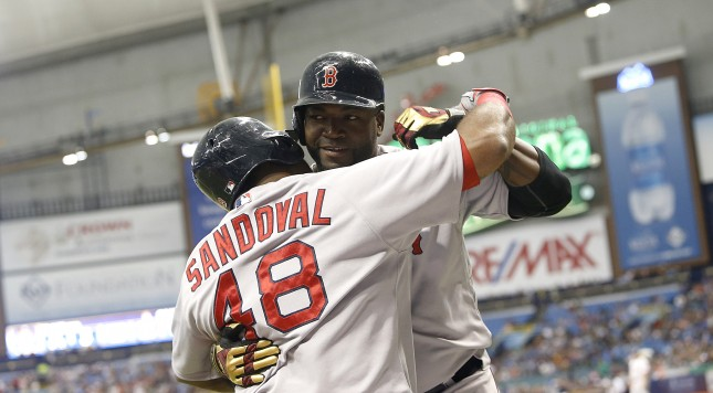 ST. PETERSBURG, FL - SEPTEMBER 12:  David Ortiz #34 of the Boston Red Sox hugs teammate Pablo Sandoval #48 as he makes his way back to the dugout after hitting his 499th career MLB home run off of pitcher Matt Moore #55 of the Tampa Bay Rays, during the first inning of a game on September 12, 2015 at Tropicana Field in St. Petersburg, Florida.  (Photo by Brian Blanco/Getty Images)