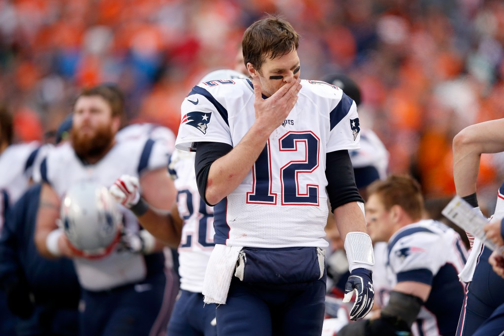 DENVER, CO - JANUARY 24: Tom Brady #12 of the New England Patriots reacts in the second half against the Denver Broncos in the AFC Championship game at Sports Authority Field at Mile High on January 24, 2016 in Denver, Colorado.  (Photo by Ezra Shaw/Getty Images)