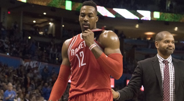 OKLAHOMA CITY, OK - JANUARY 29: Dwight Howard #12 of the Houston Rockets leaves the game after he was ejected during the third quarter of a NBA game against the Oklahoma City Thunder at the Chesapeake Energy Arena on January 29, 2016 in Oklahoma City, Oklahoma. NOTE TO USER: User expressly acknowledges and agrees that, by downloading and or using this photograph, User is consenting to the terms and conditions of the Getty Images License Agreement. (Photo by J Pat Carter/Getty Images)