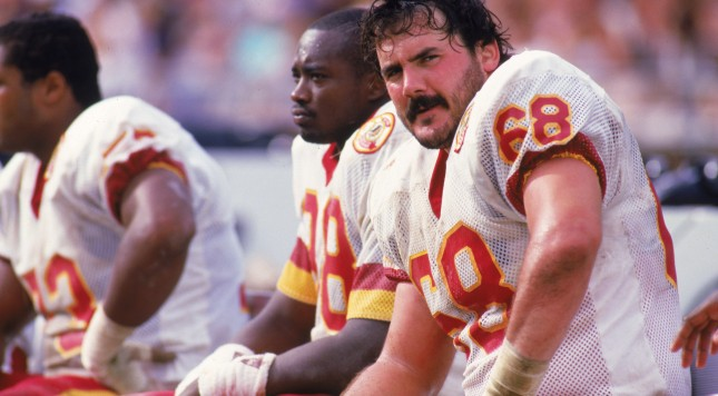 1987:  Offensive linebacker Russ Grimm #68 of the Washington Redskins sits on the bench during a 1987 season game. (Photo by Rick Stewart/Getty Images)