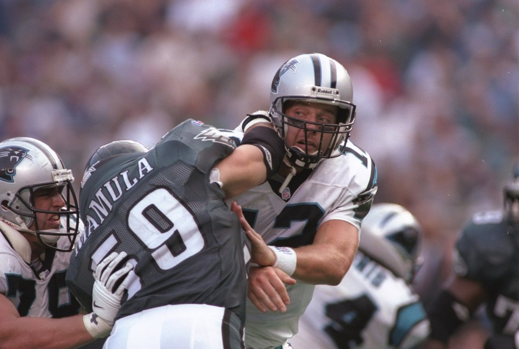 27 Oct 1996: Quarterback Kerry Collins of the Carolina Panthers is hit by defensive end Mike Mamula #59 of the Philadelphia Eagles during the Panthers 20-9 loss to the Eagles at Veterans Stadium in Philadelphia, Pennyslvania.