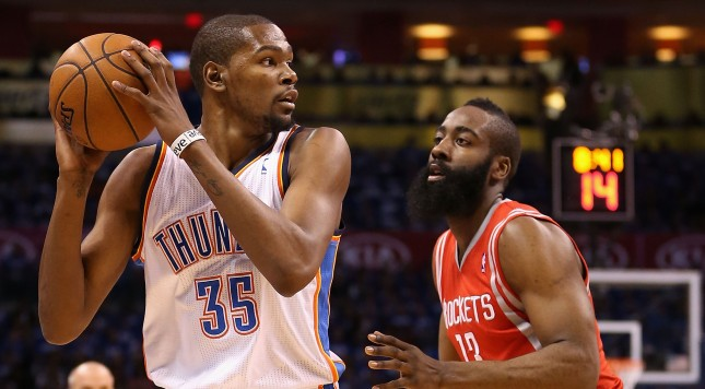 OKLAHOMA CITY, OK - APRIL 21:  Kevin Durant #35 of the Oklahoma City Thunder looks to pass the ball guarded by James Harden #13 of the Houston Rockets during the first half of Game One of the Western Conference Quarterfinals of the 2013 NBA Playoffs at Chesapeake Energy Arena on April 21, 2013 in Oklahoma City, Oklahoma. The Thunder defeated the Rockets 120-91. NOTE TO USER: User expressly acknowledges and agrees that, by downloading and or using this photograph, User is consenting to the terms and conditions of the Getty Images License Agreement.  (Photo by Christian Petersen/Getty Images)