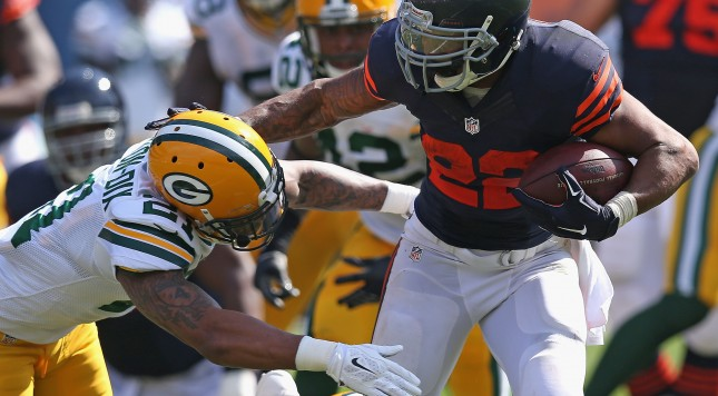 CHICAGO, IL - SEPTEMBER 28:  Matt Forte #22 of the Chicago Bears tries to avoid a tackle by Ha Ha Clinton-Dix #21 of the Green Bay Packers during the first quarter at Soldier Field on September 28, 2014 in Chicago, Illinois. The Packers defeated the Bears 38-17. (Photo by Jonathan Daniel/Getty Images)