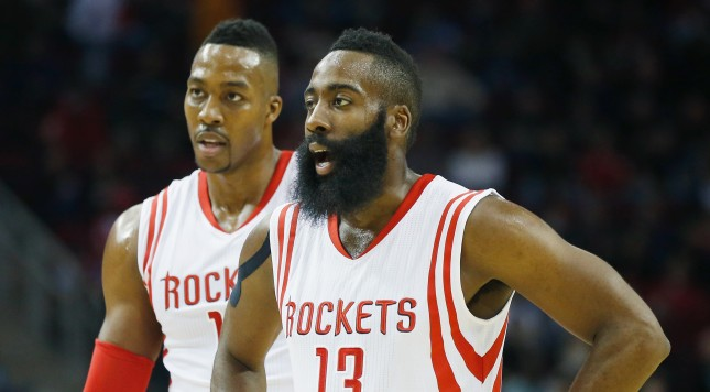 HOUSTON, TX - NOVEMBER 14:  James Harden #13 and Dwight Howard #12  of the Houston Rockets wait on the court during the game against the Philadelphia 76ers at the Toyota Center on November 14, 2014 in Houston, Texas.  NOTE TO USER: User expressly acknowledges and agrees that, by downloading and/or using this photograph, user is consenting to the terms and conditions of the Getty Images License Agreement.  (Photo by Scott Halleran/Getty Images)