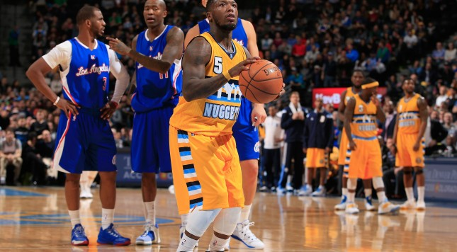 DENVER, CO - DECEMBER 19:  Nate Robinson #5 of the Denver Nuggets shoot a technical foul free throw against the Los Angeles Clippers at Pepsi Center on December 19, 2014 in Denver, Colorado. The Nuggets defeated the Clippers 109-106. NOTE TO USER: User expressly acknowledges and agrees that, by downloading and or using this photograph, User is consenting to the terms and conditions of the Getty Images License Agreement.  (Photo by Doug Pensinger/Getty Images)