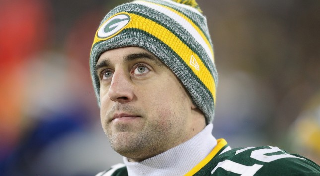 GREEN BAY, WI - DECEMBER 28:  Quarterback Aaron Rodgers #12 of the Green Bay Packers looks on during the NFL game against the Detroit Lions at Lambeau Field on December 28, 2014 in Green Bay, Wisconsin. The Green Bay Packers defeat the Detroit Lions 30-20. (Photo by Mike McGinnis/Getty Images)