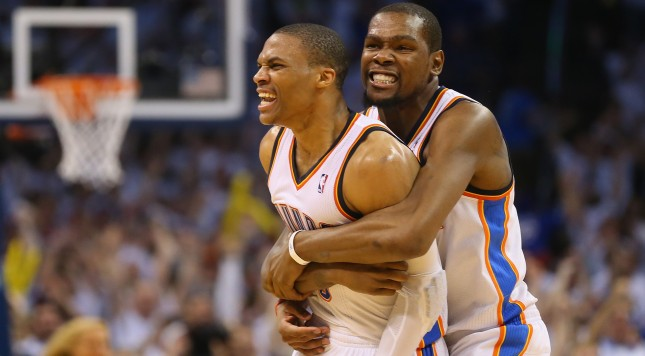 OKLAHOMA CITY, OK - MAY 13:  (L-R) Russell Westbrook #0 and Kevin Durant celebrate a 105-104 win against the Los Angeles Clippers in Game Five of the Western Conference Semifinals during the 2014 NBA Playoffs at Chesapeake Energy Arena on May 13, 2014 in Oklahoma City, Oklahoma. NOTE TO USER: User expressly acknowledges and agrees that, by downloading and or using this photograph, User is consenting to the terms and conditions of the Getty Images License Agreement.  (Photo by Ronald Martinez/Getty Images)