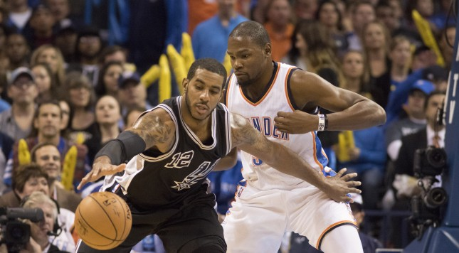 OKLAHOMA CITY, OK - OCTOBER 28:  LaMarcus Aldridge #12 of the San Antonio Spurs is defended by Kevin Durant #35 of the Oklahoma City Thunder during the  first quarter of a NBA game at the Chesapeake Energy Center on October 28, 2015 in Oklahoma City, Oklahoma. NOTE TO USER: User expressly acknowledges and agrees that, by downloading and or using this photograph, User is consenting to the terms and conditions of the Getty Images License Agreement. (Photo by J Pat Carter/Getty Images)