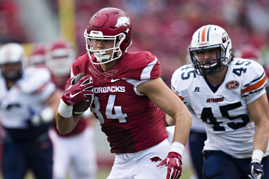 FAYETTEVILLE, AR - OCTOBER 31: Hunter Henry #84 of the Arkansas Razorbacks runs the ball after catching a pass during a game against the UT Martin Skyhawks at Razorback Stadium on October 31, 2015 in Fayetteville, Arkansas. The Razorbacks defeated the Skyhawks 63-28. (Photo by Wesley Hitt/Getty Images)