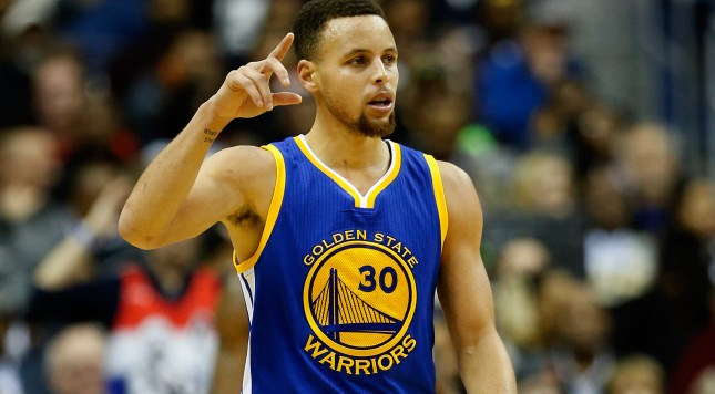 WASHINGTON, DC - FEBRUARY 03:  Stephen Curry #30 of the Golden State Warriors celebrates after scoring in the foiurth quarter against the Washington Wizards at Verizon Center on February 3, 2016 in Washington, DC. The Warriors defeated the Wizards 134 to 121. NOTE TO USER: User expressly acknowledges and agrees that, by downloading and or using this photograph, User is consenting to the terms and conditions of the Getty Images License Agreement.  (Photo by Rob Carr/Getty Images)