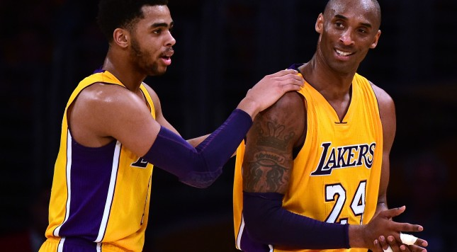 LOS ANGELES, CA - MARCH 10:  Kobe Bryant #24 and D'Angelo Russell #1 of the Los Angeles Lakers react after a foul during a 120-108 Cleveland Cavaliers win at Staples Center on March 10, 2016 in Los Angeles, California.  NOTE TO USER: User expressly acknowledges and agrees that, by downloading and or using this Photograph, user is consenting to the terms and condition of the Getty Images License Agreement.  (Photo by Harry How/Getty Images)
