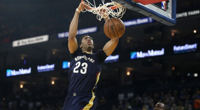 OAKLAND, CA - MARCH 14:  Anthony Davis #23 of the New Orleans Pelicans dunks the ball over Draymond Green #23 of the Golden State Warriors at ORACLE Arena on March 14, 2016 in Oakland, California. NOTE TO USER: User expressly acknowledges and agrees that, by downloading and or using this photograph, User is consenting to the terms and conditions of the Getty Images License Agreement.  (Photo by Ezra Shaw/Getty Images)