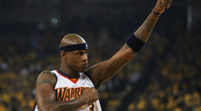 OAKLAND, CA - MAY 11:  Al Harrington #3 of the Golden State Warriors points to the stands in Game Three of the Western Conference Semifinals during the 2007 NBA Playoffs at Oracle Arena May 11, 2007 in Oakland, California. NOTE TO USER: User expressly acknowledges and agrees that, by downloading and or using this photograph, user is consenting to the terms and conditions of the Getty Images License Agreement.  (Photo by Justin Sullivan/Getty Images)
