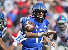 MEMPHIS, TN - OCTOBER 17:  Paxton Lynch #12 of the Memphis Tigers makes a pitch to the running back during a game against the Ole Miss Rebels at Liberty Bowl Memorial Stadium on October 17, 2015 in Memphis, Tennessee.  The Tigers defeated the Rebels 37-24.  (Photo by Wesley Hitt/Getty Images)