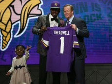CHICAGO, IL - APRIL 28:  Laquon Treadwell of Ole Miss holds up a jersey with his daughter Madison and NFL Commissioner Roger Goodell after being picked #23 overall by the Minnesota Vikings during the first round of the 2016 NFL Draft at the Auditorium Theatre of Roosevelt University on April 28, 2016 in Chicago, Illinois.  (Photo by Jon Durr/Getty Images)