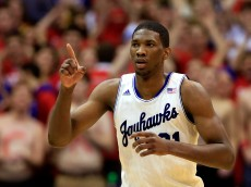 LAWRENCE, KS - JANUARY 18:  Joel Embiid #21 of the Kansas Jayhawks reacts after scoring during the game against the Oklahoma State Cowboys at Allen Fieldhouse on January 18, 2014 in Lawrence, Kansas.  (Photo by Jamie Squire/Getty Images)