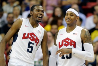 LAS VEGAS, NV - JULY 12:  Kevin Durant #5 and Carmelo Anthony #15 of the US Men's Senior National Team chat on the sideline during a pre-Olympic exhibition game against the Dominican Republic at Thomas & Mack Center on July 12, 2012 in Las Vegas, Nevada. The United States won the game 113-59.  (Photo by David Becker/Getty Images)