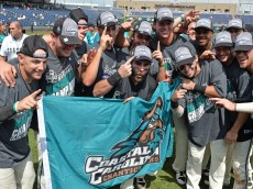 Omaha, NE - JUNE 30:  Players of the Coastal Carolina Chanticleers after defeating the Arizona Wildcats 4-3 for the National Championship at the College World Series Championship Series on June 30, 2016 at TD Ameritrade Park in Omaha, Nebraska.  (Photo by Peter Aiken/Getty Images)