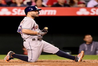 ANAHEIM, CA - MAY 28:  Jose Altuve #27 of the Houston Astros reacts after his swing during the fifth inning against the Los Angeles Angels at Angel Stadium of Anaheim on May 28, 2016 in Anaheim, California.  (Photo by Harry How/Getty Images)