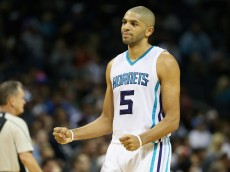 CHARLOTTE, NC - DECEMBER 07:  Nicolas Batum #5 of the Charlotte Hornets reacts after a play during their game against the Detroit Pistons at Time Warner Cable Arena on December 7, 2015 in Charlotte, North Carolina. NBA - NOTE TO USER: User expressly acknowledges and agrees that, by downloading and or using this photograph, User is consenting to the terms and conditions of the Getty Images License Agreement.  (Photo by Streeter Lecka/Getty Images)