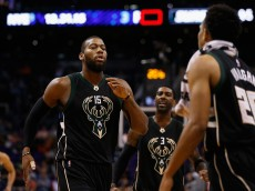 PHOENIX, AZ - DECEMBER 20:  Greg Monroe #15 of the Milwaukee Bucks celebrates with O.J. Mayo #3 and Rashad Vaughn #20 after scoring against the Phoenix Suns during the second half of the NBA game at Talking Stick Resort Arena on December 20, 2015 in Phoenix, Arizona.   The Bucks defeated the Suns 101-95. NOTE TO USER: User expressly acknowledges and agrees that, by downloading and or using this photograph, User is consenting to the terms and conditions of the Getty Images License Agreement.  (Photo by Christian Petersen/Getty Images)