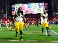 GLENDALE, AZ - JANUARY 16:  Running back Eddie Lacy #27 and defensive end outside linebacker Mike Neal #96 of the Green Bay Packers walk off the field after losing in overtime to the Arizona Cardinals 26-20  in the NFC Divisional Playoff Game at University of Phoenix Stadium on January 16, 2016 in Glendale, Arizona.  (Photo by Jennifer Stewart/Getty Images)