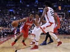 TORONTO, ON - APRIL 12:  Ish Smith #1 of the  Philadelphia 76ers dribbles the ball around Lucas Nogueira #92 of the Toronto Raptors during the first half of an NBA game at the Air Canada Centre on April 12, 2016 in Toronto, Ontario, Canada.  NOTE TO USER: User expressly acknowledges and agrees that, by downloading and or using this photograph, User is consenting to the terms and conditions of the Getty Images License Agreement.  (Photo by Vaughn Ridley/Getty Images)