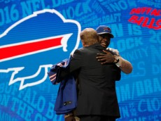 CHICAGO, IL - APRIL 28:  (L-R) Shaq Lawson of Clemson holds up a jersey with NFL Commissioner Roger Goodell after being picked #19 overall by the Buffalo Bills during the first round of the 2016 NFL Draft at the Auditorium Theatre of Roosevelt University on April 28, 2016 in Chicago, Illinois.  (Photo by Jon Durr/Getty Images)
