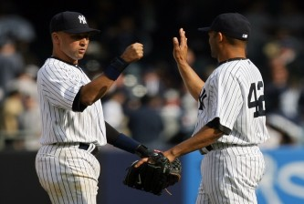 NEW YORK - APRIL 13:  Derek Jeter #2 and Mariano Rivera #42 of the New York Yankees celebrate after defeating the Los Angeles Angels of Anaheim during the Yankees home opener at Yankee Stadium on April 13, 2010 in the Bronx borough of New York City.  (Photo by Chris Trotman/Getty Images)
