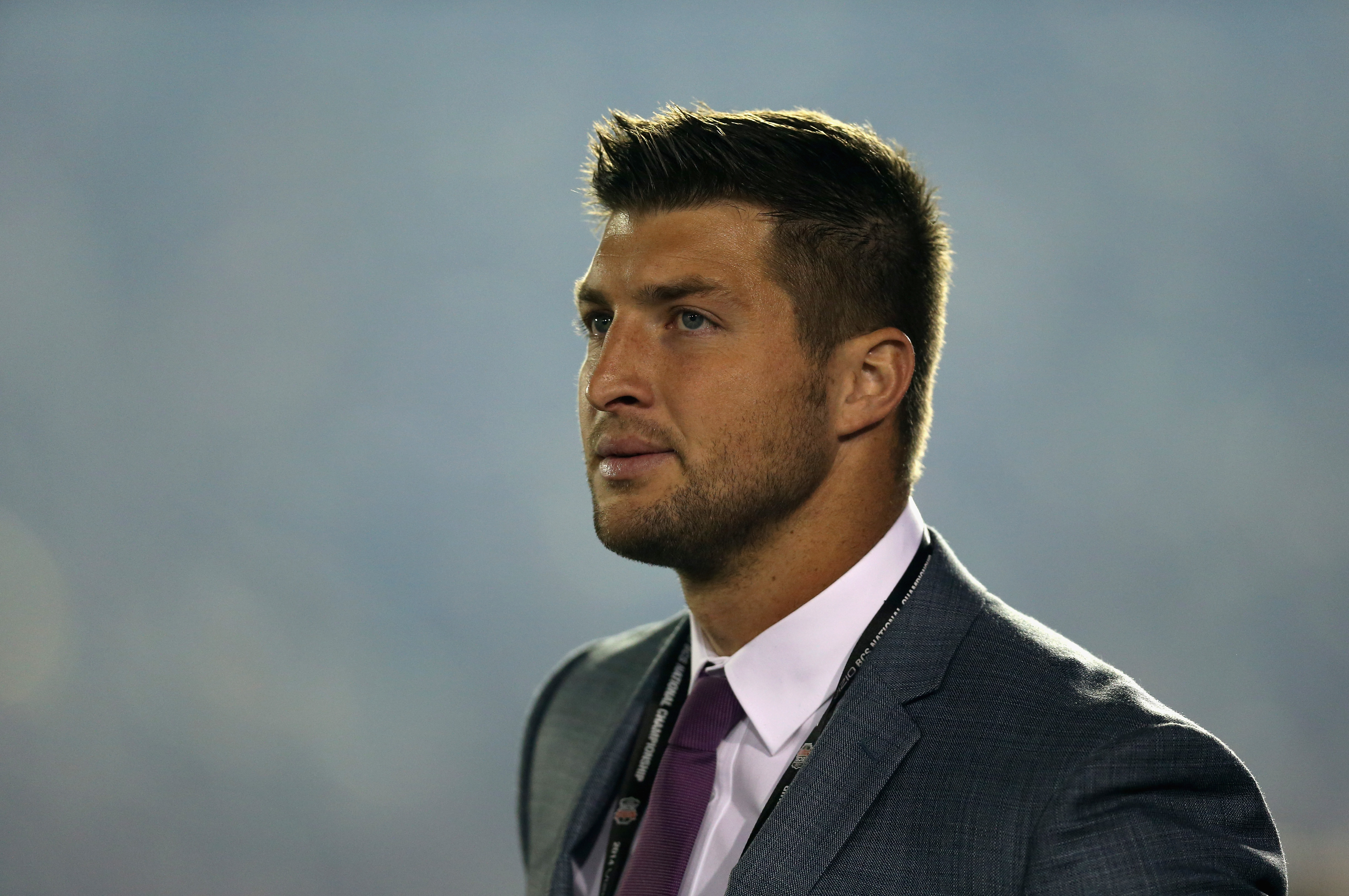 PASADENA, CA - JANUARY 06:  ESPN analyst Tim Tebow looks on during the 2014 Vizio BCS National Championship Game between the Florida State Seminoles and the Auburn Tigers at the Rose Bowl on January 6, 2014 in Pasadena, California.  (Photo by Jeff Gross/Getty Images)