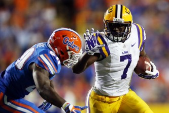 BATON ROUGE, LA - OCTOBER 17:  Leonard Fournette #7 of the LSU Tigers runs for a first down past Marcus Maye #20 of the Florida Gators at Tiger Stadium on October 17, 2015 in Baton Rouge, Louisiana.  (Photo by Chris Graythen/Getty Images)