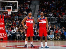 ATLANTA, GA - MARCH 21:  John Wall #2 and Bradley Beal #3 of the Washington Wizards look on during free throws against the Atlanta Hawks at Philips Arena on March 21, 2016 in Atlanta, Georgia.  NOTE TO USER User expressly acknowledges and agrees that, by downloading and or using this photograph, user is consenting to the terms and conditions of the Getty Images License Agreement.  (Photo by Kevin C. Cox/Getty Images)