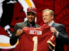 CHICAGO, IL - APRIL 28:  (L-R) Josh Doctson of TCU  holds up a jersey with NFL Commissioner Roger Goodell after being picked #22 overall by the Washington Redskins during the first round of the 2016 NFL Draft at the Auditorium Theatre of Roosevelt University on April 28, 2016 in Chicago, Illinois.  (Photo by Jon Durr/Getty Images)