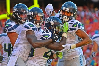 KANSAS CITY, MO - AUGUST 13:  Running back Troymaine Pope #26 of the Seattle Seahawks celebrates with his teammates after scoring the game winning two point conversion against the Kansas City Chiefs during the second half on August 13, 2016 at Arrowhead Stadium in Kansas City, Missouri.  (Photo by Peter Aiken/Getty Images)